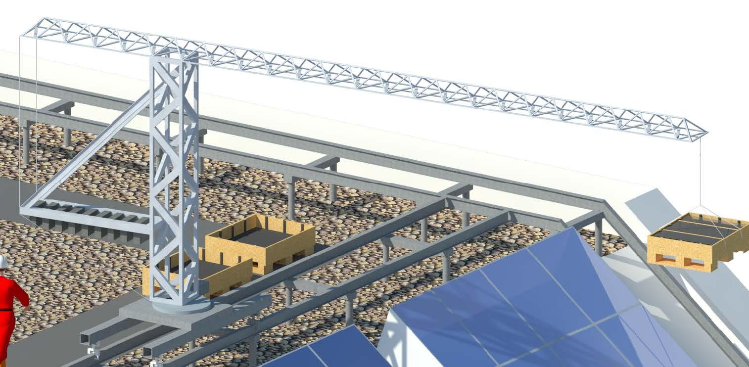 Kraan geplaatst op rails transporteert glaspanelen over eerste niveau